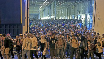 illegal-muslims-picked-up-to-arrive-at-the-port-of-piraeus-near-athens-after-travelling-in-passenger-ship-from-lesbos