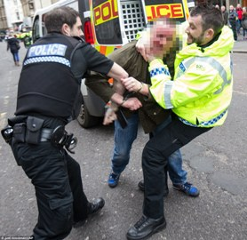 262DFE5E00000578-2973413-A_man_is_wrestled_to_the_ground_as_violent_clashes_take_place_in-m-122_1425137702241