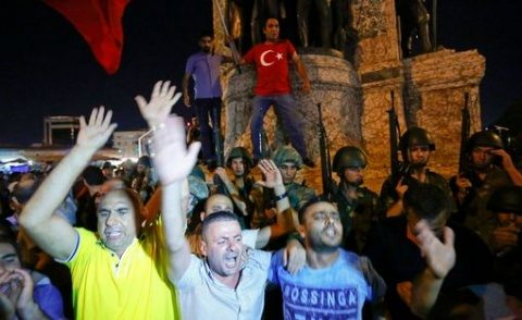 People-demonstrate-in-front-of-the-Republic-Monument-at-the-Taksim-Square-in-Istanbul
