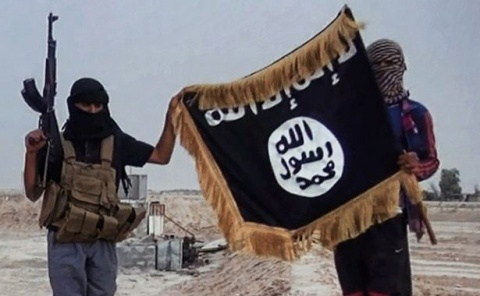 2014_10_14_militants-of-the-islamic-state-posing-with-the-jihadists-flag_rsz_crp
