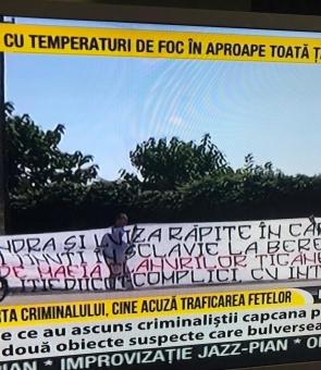Banner prin care SRI și DIICOT sunt acuzate de complicitate cu traficanții de carne vie la Caracal